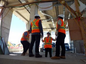 Joanna Kervin, Director, Third Party, Planning and Property, TYSSE gives DUKE a tour of the Finch West Bus Terminal, June 29, 2016